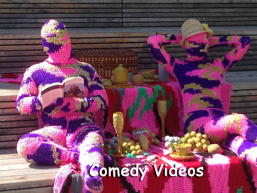couple in knitted outfits sitting on knitted blanket