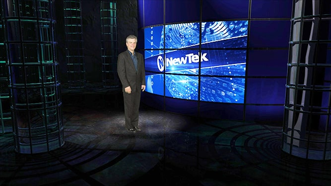 Man standing in front of NEWTEK large screen