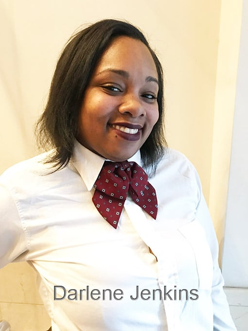 Attractive, black young woman in white blouse with caption Darlene Jenkins