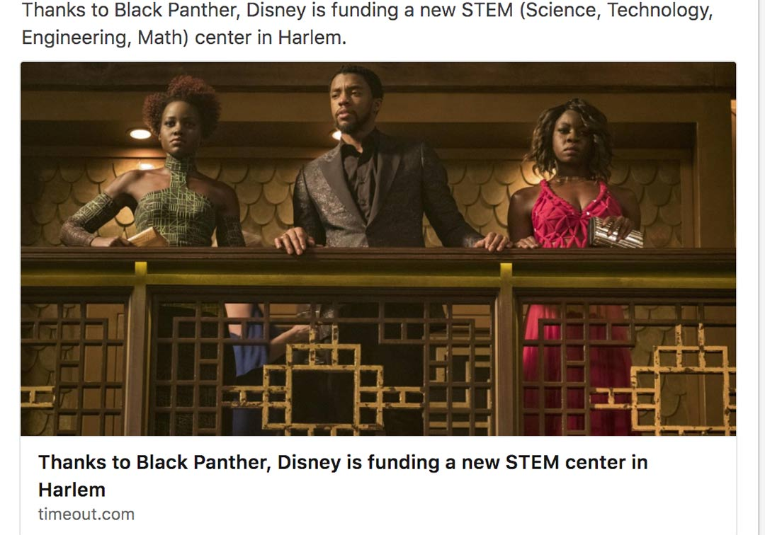 still form Movie Black Panther with three characters on a balcony facing camera.
