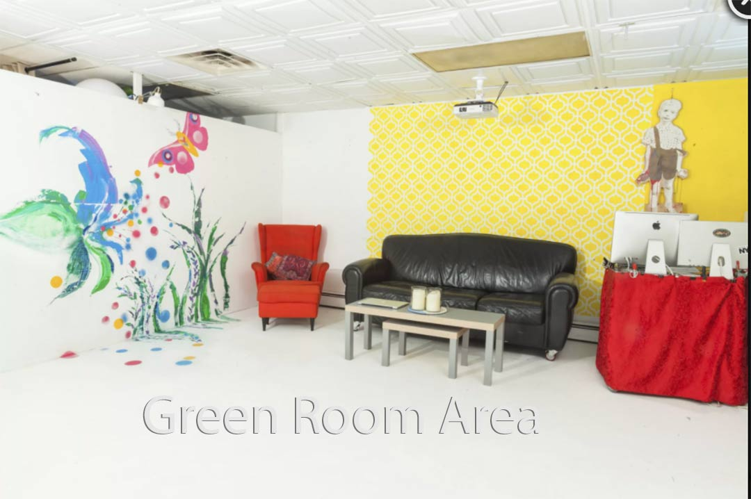 New Green Room Area with red couch and black chair