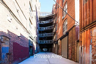 Private Alley 320 daylight wide . brick walls