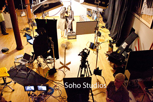 Huge studio sees form high down shot. Full crew and talent against white cyc