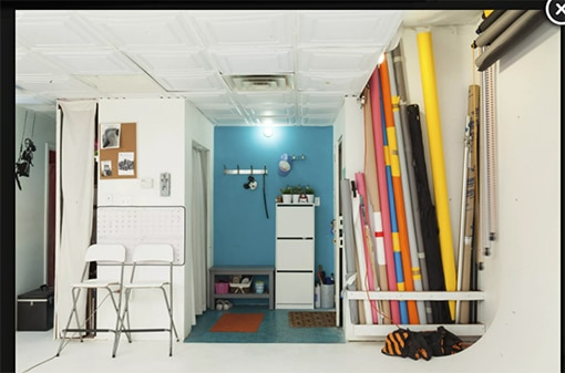 Tribeca photo/video loft with white wall and multicolored rolls of seamless paper