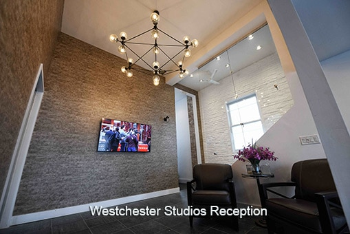 Westchester studios Reception area large TV bright wall two chairs