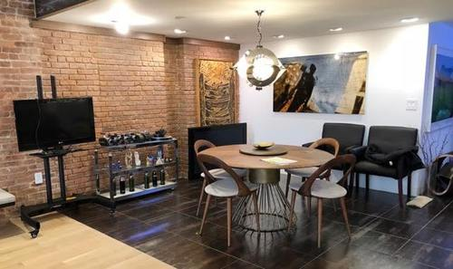 * Image Tribeca studio and loft breakfast nook Rental . brick wall, table and chairs