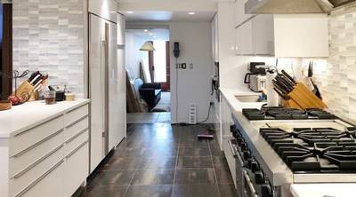 Tribeca studio and loft kitchen . with all white appliances left and right
