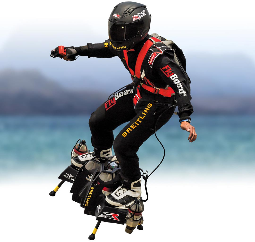 Test Pilot in the air waring a black and red flight suit with a FlyBoard Air