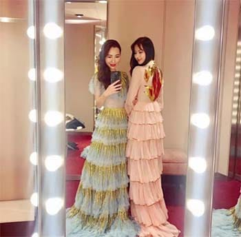 Two beautiful Chinese Women in designer costumes