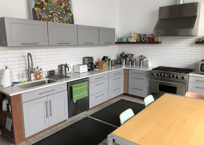 Kitchen with stove, sink, dishwasher, appliances and kitchen ware.