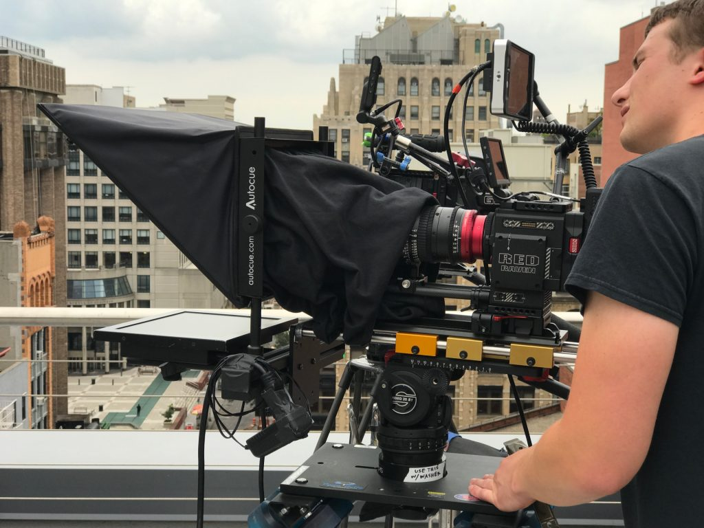 Operator on roof with teleprompter
