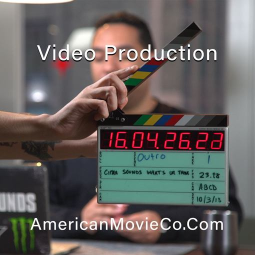 NYC Video Production - hand clapping slate - man out of focus in background