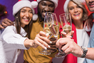 Happy group doing a toast at Christmas party