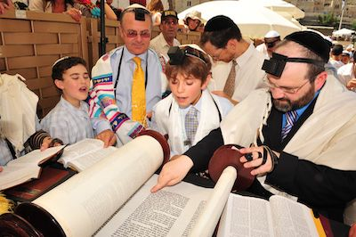 Rabbi and kids soon to be adults read the Torah Live Streaming or WebCasting  this event