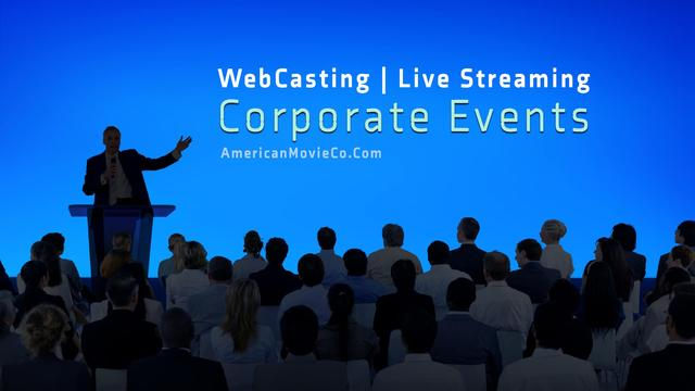 Large group at Corporate Event  listen to man at podium - all in silhouette - blue background.